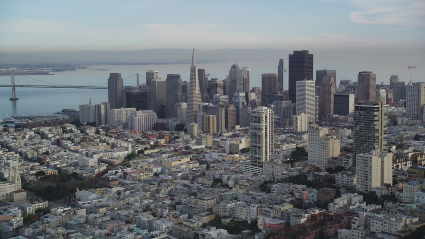5K stock footage aerial video pan from Coit Tower and Bay Bridge to Downtown San Francisco skyscrapers, California Aerial Stock Footage | DFKSF06_169
