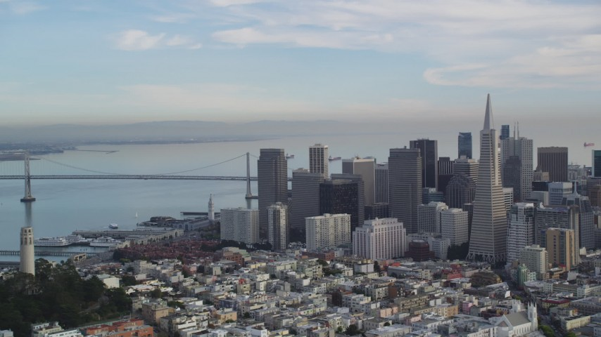 5K aerial video of Coit Tower, Transamerica Pyramid and skyscrapers, Bay Bridge, Downtown San Francisco, California Aerial Stock Footage | DFKSF06_174