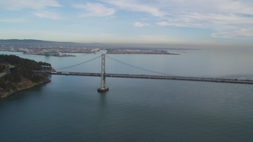 5K stock footage aerial video of panning across the Bay Bridge, San Francisco, California Aerial Stock Footage | DFKSF06_181