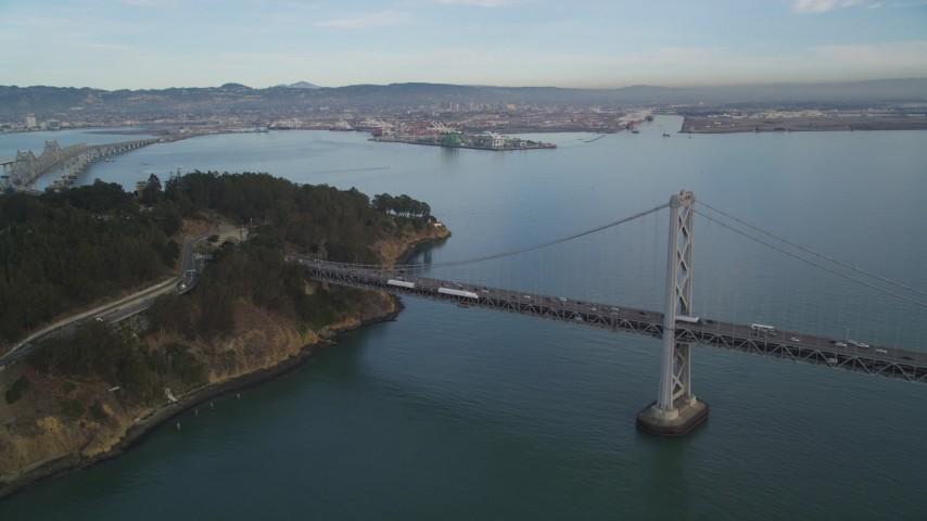 5K stock footage aerial video approach the Bay Bridge and tilt to Yerba Buena Island, San Francisco, California Aerial Stock Footage | DFKSF06_182