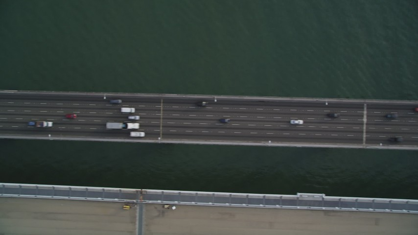 5K stock footage aerial video of a bird's eye view of traffic crossing the upper deck of Bay Bridge, San Francisco, California Aerial Stock Footage | DFKSF06_185