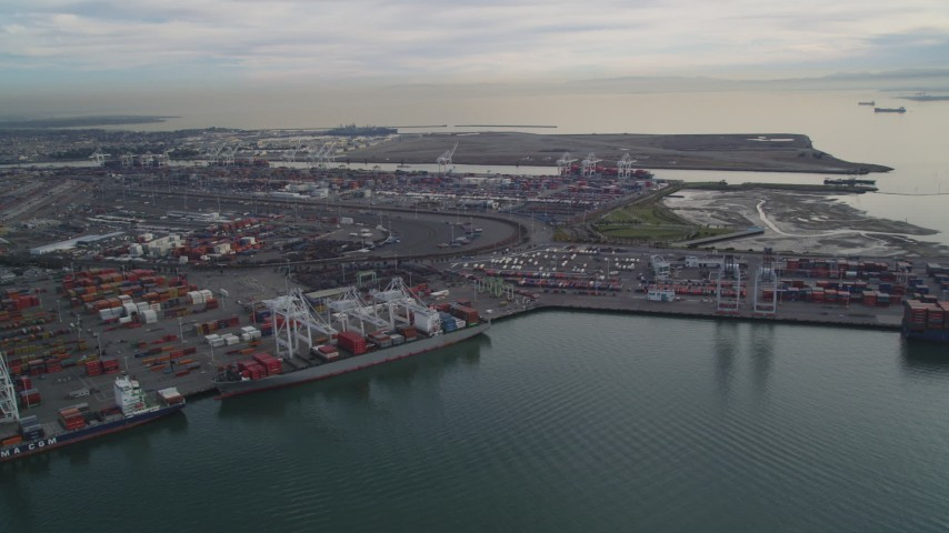 5K stock footage aerial video of flying by the Port of Oakland, California Aerial Stock Footage | DFKSF06_186