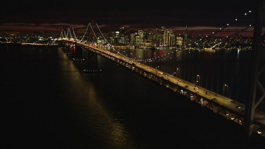 5K stock footage aerial video approach the Bay Bridge with the city skyline in the distance, San Francisco, California, night Aerial Stock Footage | DFKSF07_002