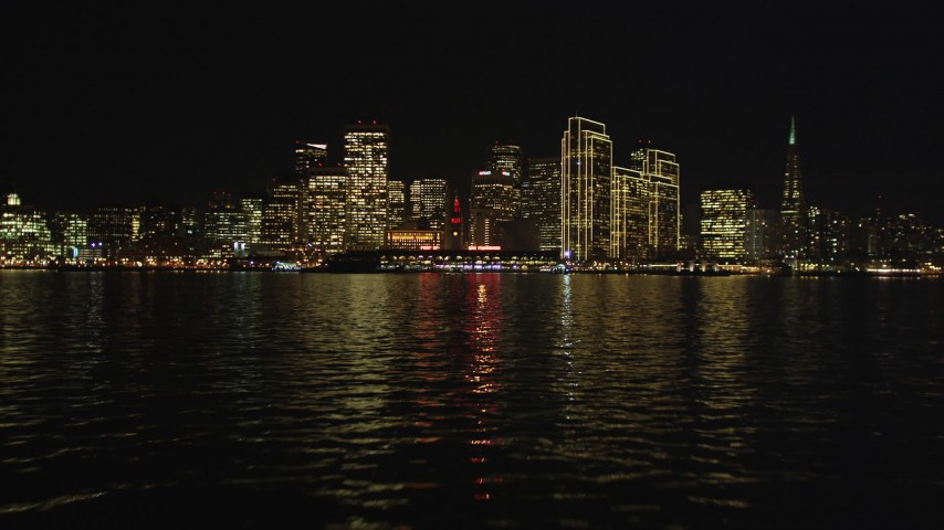 5K stock footage aerial video of the city skyline at night seen from the bay, Downtown San Francisco, California, night Aerial Stock Footage | DFKSF07_003