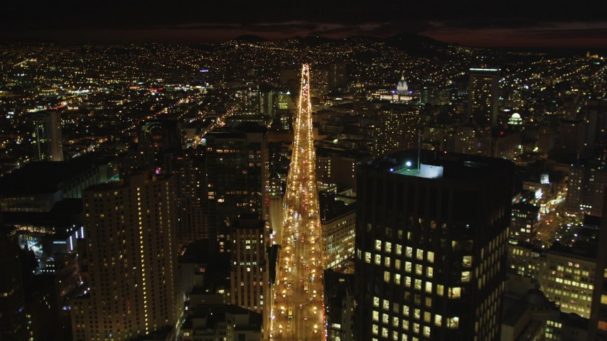 5K stock footage aerial video of flying over Market Street past skyscrapers in Downtown San Francisco, California, night Aerial Stock Footage | DFKSF07_004