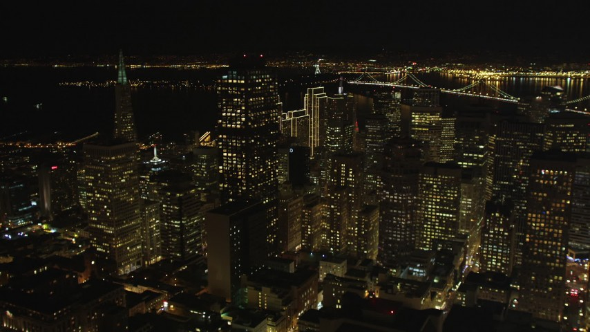 5K stock footage aerial video tilt from apartment and office buildings to reveal skyscrapers in Downtown San Francisco, California, night Aerial Stock Footage | DFKSF07_008