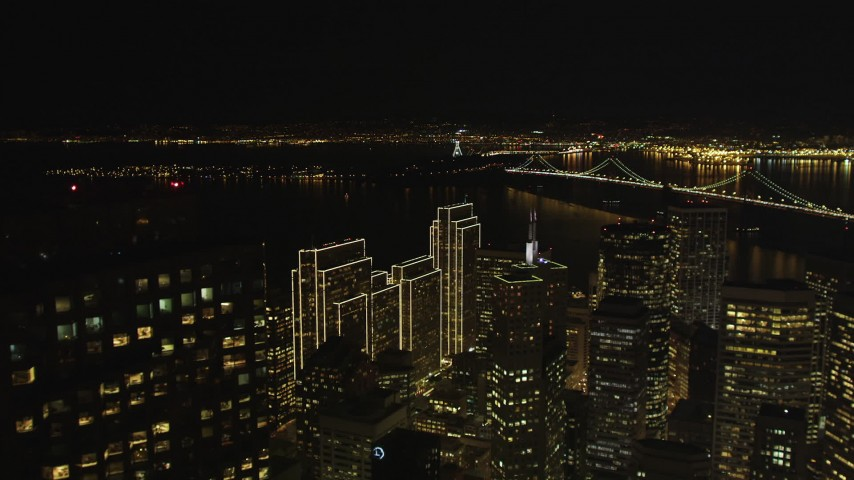 5K stock footage aerial video fly over the city's skyscrapers toward the Bay Bridge, Downtown San Francisco, California, night Aerial Stock Footage | DFKSF07_009