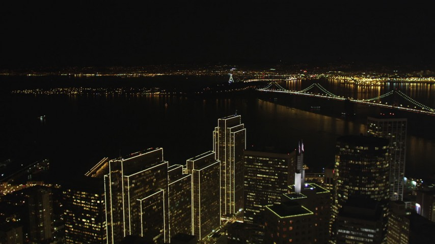 5K stock footage aerial video fly over skyscrapers to approach the Bay Bridge, Downtown San Francisco, California, night Aerial Stock Footage | DFKSF07_010