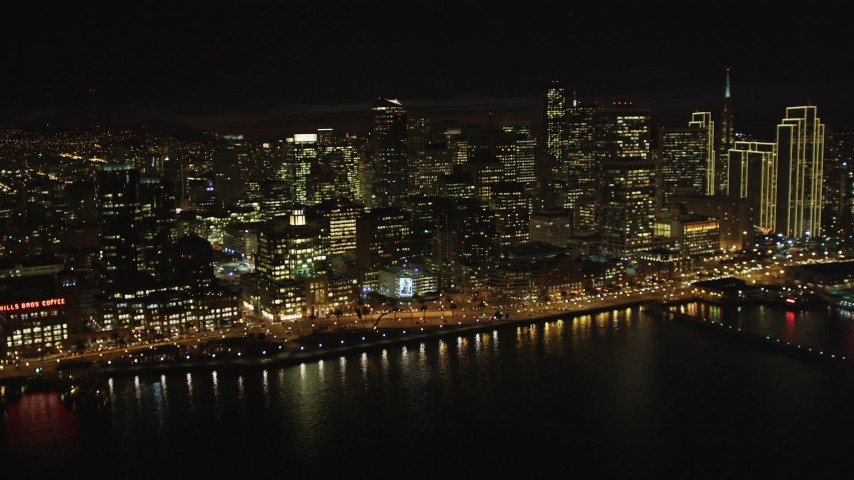 5K stock footage aerial video of approaching skyscrapers from the bay, Downtown San Francisco, California, night Aerial Stock Footage | DFKSF07_012