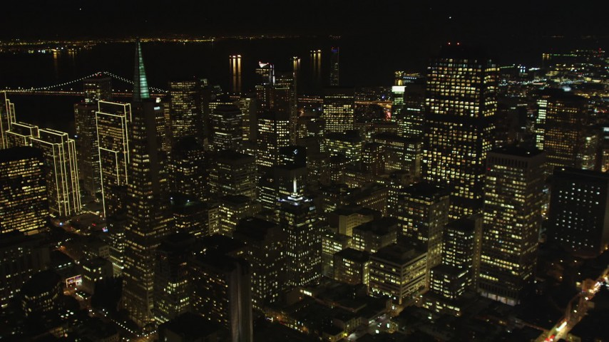 5K stock footage aerial video flyby Transamerica Pyramid and over skyscrapers, Downtown San Francisco, California, night Aerial Stock Footage | DFKSF07_016