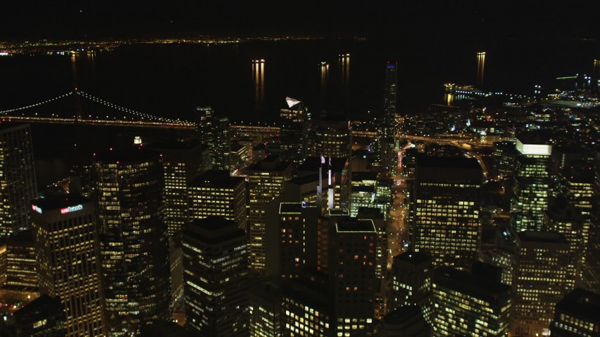 5K stock footage aerial video of flying over skyscrapers to approach the bay, Downtown San Francisco, California, night Aerial Stock Footage | DFKSF07_017