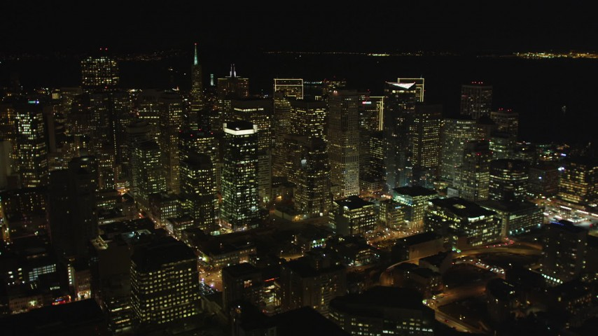 5K stock footage aerial video tilt from I-80 freeway to reveal skyscrapers in Downtown San Francisco, California, night Aerial Stock Footage | DFKSF07_019