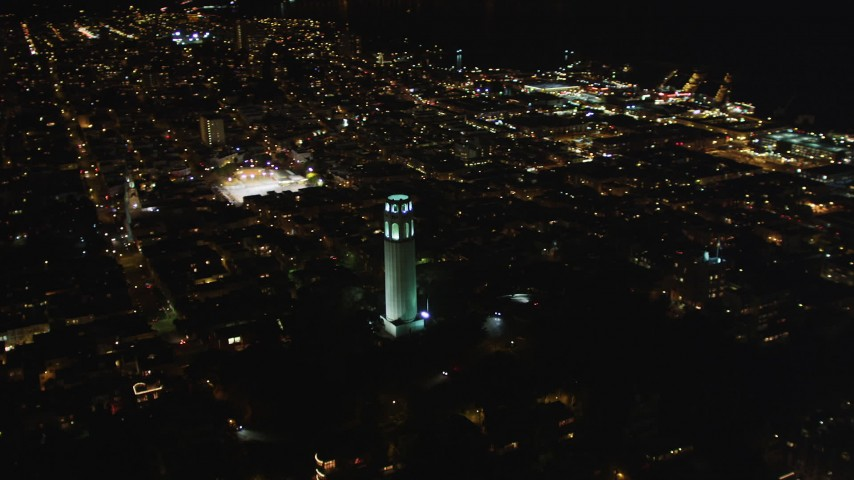 5K stock footage aerial video of flying by Coit Tower in North Beach, San Francisco, California, night Aerial Stock Footage | DFKSF07_020