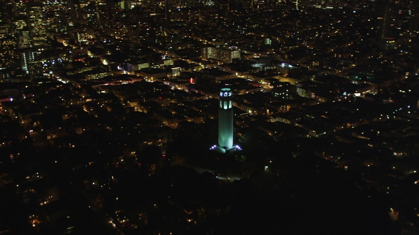 5K stock footage aerial video orbit Coit Tower, to reveal skyscrapers in Downtown San Francisco, California, night Aerial Stock Footage | DFKSF07_021