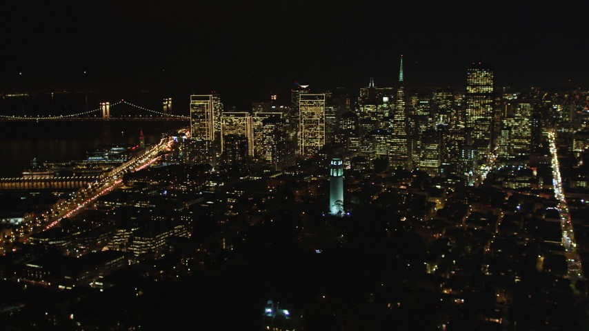 5K stock footage aerial video of Coit Tower and the city's skyscrapers, Downtown San Francisco, California, night Aerial Stock Footage | DFKSF07_022
