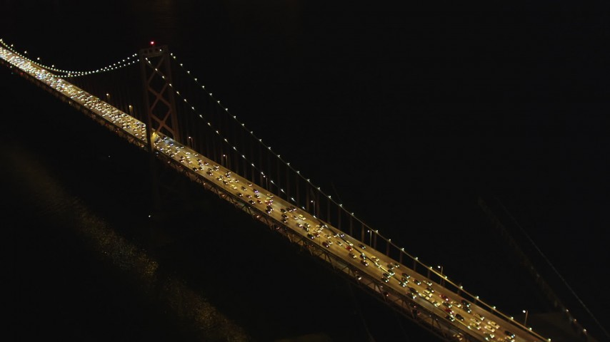 5K stock footage aerial video approach and pan across heavy Bay Bridge traffic, Downtown San Francisco, California, night Aerial Stock Footage | DFKSF07_025