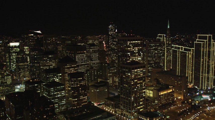 5K stock footage aerial video of tilting from the bay, revealing skyscrapers in Downtown San Francisco, California, night Aerial Stock Footage | DFKSF07_028