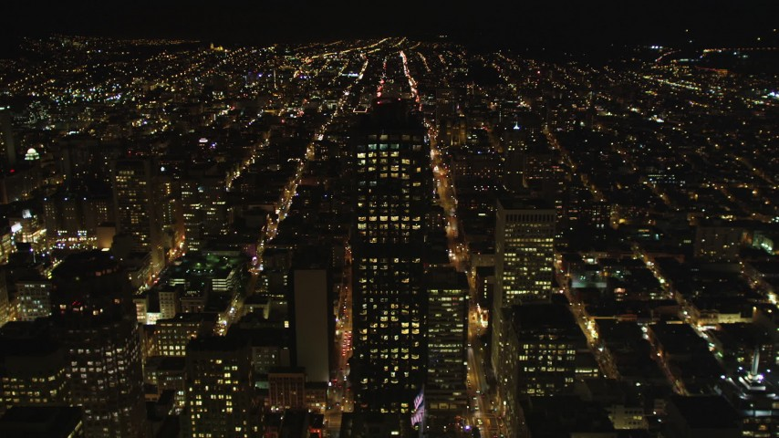 5K aerial video of approaching 555 California Street skyscraper, Downtown San Francisco, California, night Aerial Stock Footage | DFKSF07_029