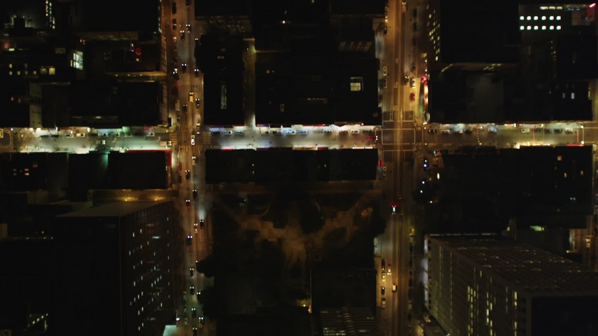 5K aerial video bird's eye view of city streets in Downtown San Francisco, California, night Aerial Stock Footage | DFKSF07_030