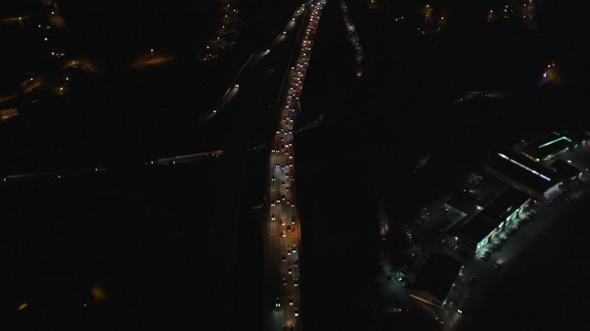 5K stock footage aerial video bird's eye Highway 101 freeway in The Presidio, reveal Highway 1 interchange, San Francisco, night Aerial Stock Footage | DFKSF07_033