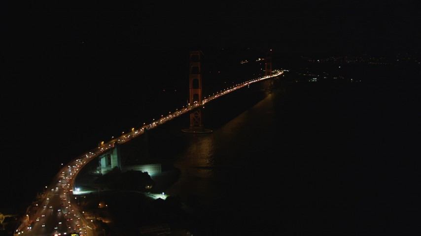 5K stock footage aerial video tilt from bird's eye of freeway interchange to reveal Golden Gate Bridge, San Francisco, California, night Aerial Stock Footage | DFKSF07_034