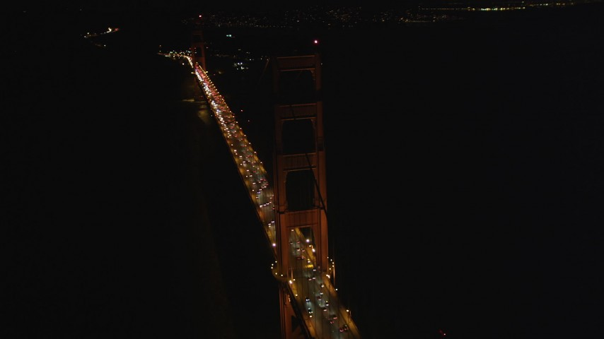 5K stock footage aerial video of circling tower on famous Golden Gate Bridge, San Francisco, California, night Aerial Stock Footage | DFKSF07_039