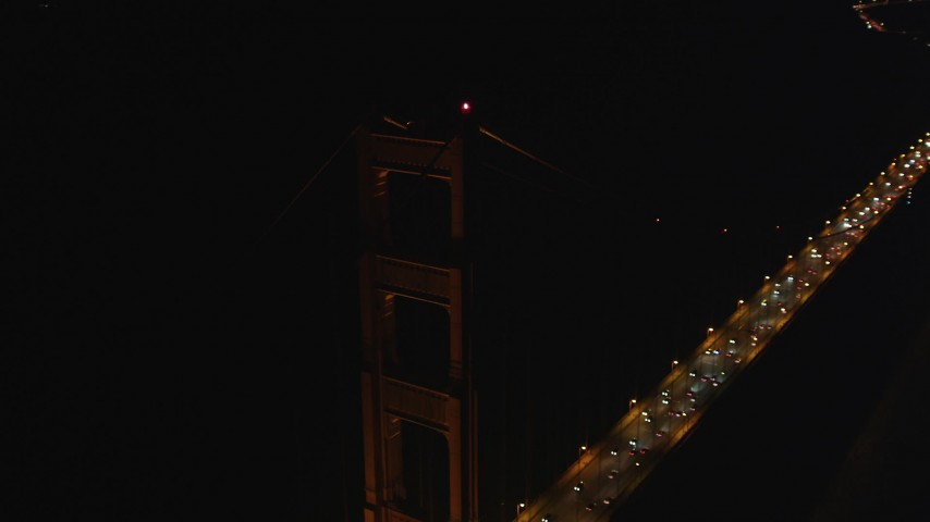 5K stock footage aerial video of circling a tower on the historic Golden Gate Bridge, San Francisco, California, night Aerial Stock Footage | DFKSF07_040