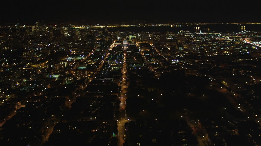 5K stock footage aerial video of following Fulton Street, tilt to reveal city hall, Western Addition, San Francisco, California, night Aerial Stock Footage | DFKSF07_050