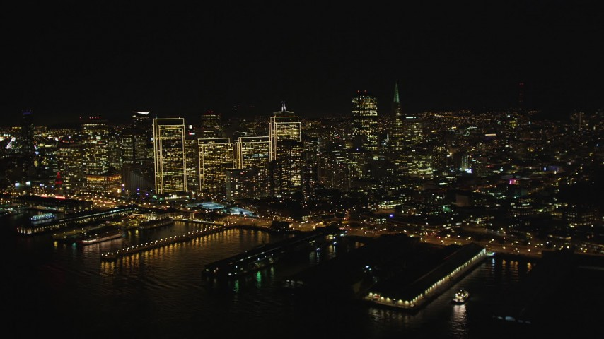 5K stock footage aerial video of flying away from the city's skyscrapers, Downtown San Francisco, California, night Aerial Stock Footage | DFKSF07_057