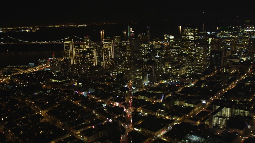 5K stock footage aerial video of tilting from Columbus Ave to reveal skyscrapers in Downtown San Francisco, California, night Aerial Stock Footage | DFKSF07_058