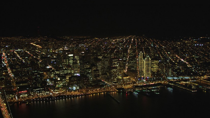 5K stock footage aerial video of city skyscrapers seen from a high altitude, Downtown San Francisco, California, night Aerial Stock Footage | DFKSF07_061