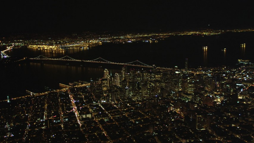 5K stock footage aerial video of a wide view of the Bay Bridge and Downtown San Francisco skyscrapers, California, night Aerial Stock Footage | DFKSF07_064