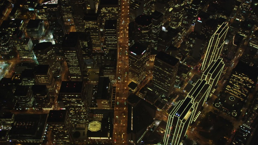 5K stock footage aerial video of a bird's eye of Market Street and skyscrapers, Downtown San Francisco, California, night Aerial Stock Footage | DFKSF07_071