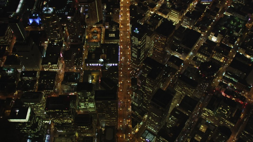 5K stock footage aerial video bird's eye of Market Street, Union Square, Downtown San Francisco skyscrapers, California, night Aerial Stock Footage | DFKSF07_072