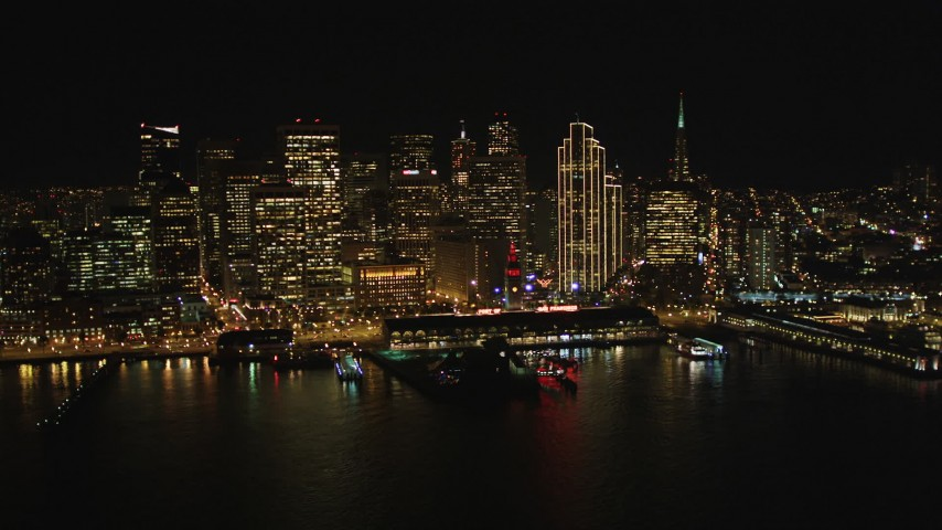 5K stock footage aerial video fly away from the Ferry Building and skyscrapers in Downtown San Francisco, California, night Aerial Stock Footage | DFKSF07_075