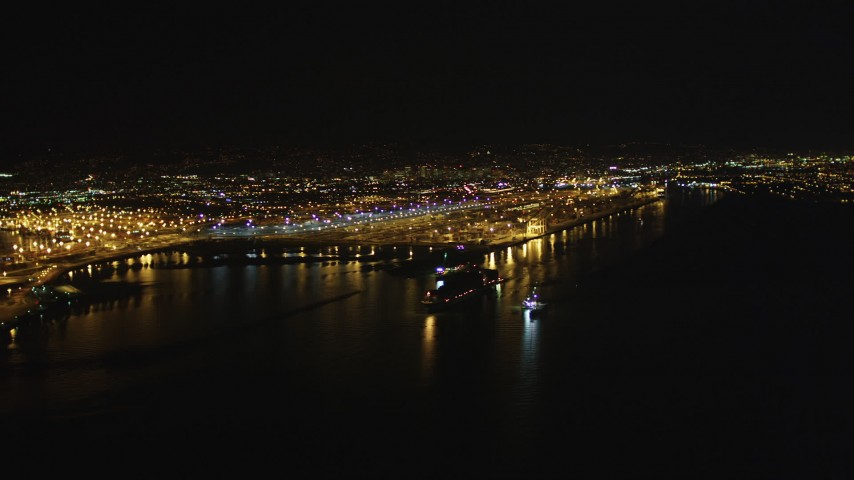 5K stock footage aerial video of panning across the Port of Oakland, California, night Aerial Stock Footage | DFKSF07_076