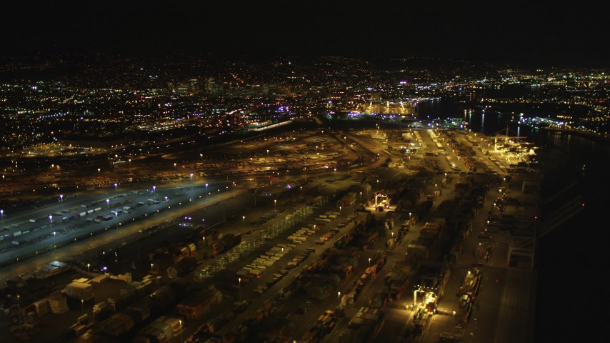 5K aerial stock footage video of flying over rows of containers at the Port of Oakland, California, night Aerial Stock Footage | DFKSF07_078