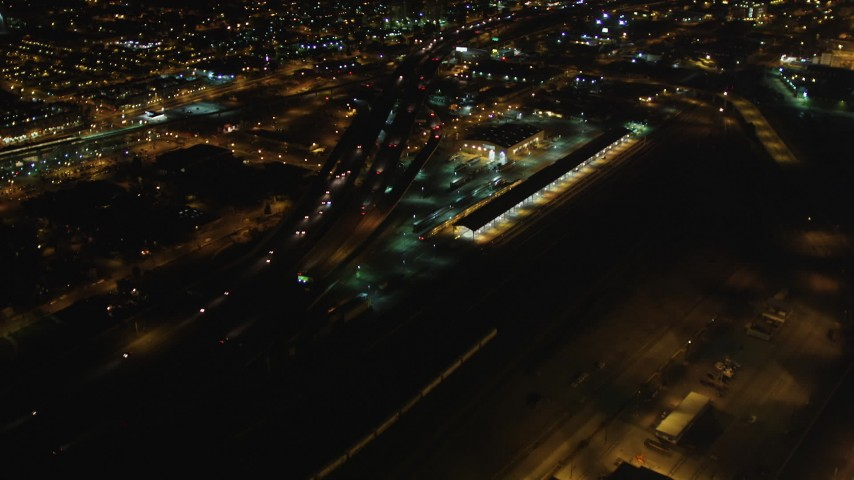 5K stock footage aerial video fly over I-880, tilt revealing Downtown Oakland, California, night Aerial Stock Footage | DFKSF07_079