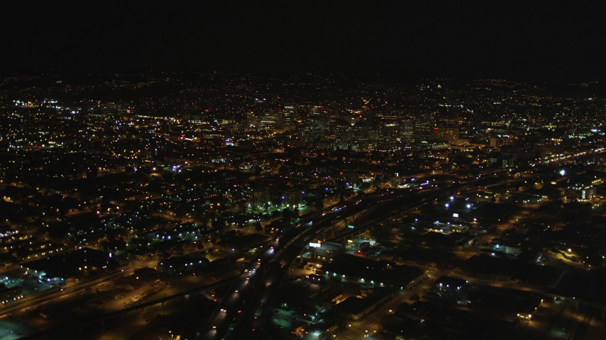 5K stock footage aerial video of flying over I-880 freeway toward Downtown Oakland, California, night Aerial Stock Footage | DFKSF07_080