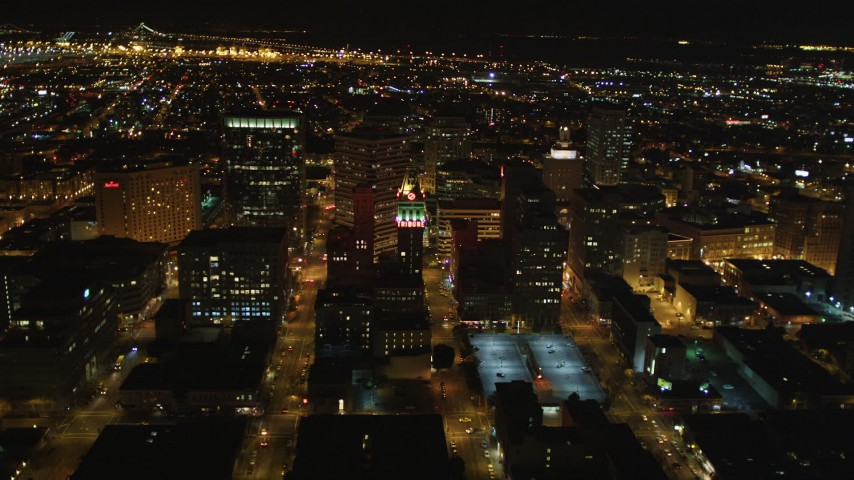 5K stock footage aerial video approach Tribune Tower office building in Downtown Oakland, California, night Aerial Stock Footage | DFKSF07_081