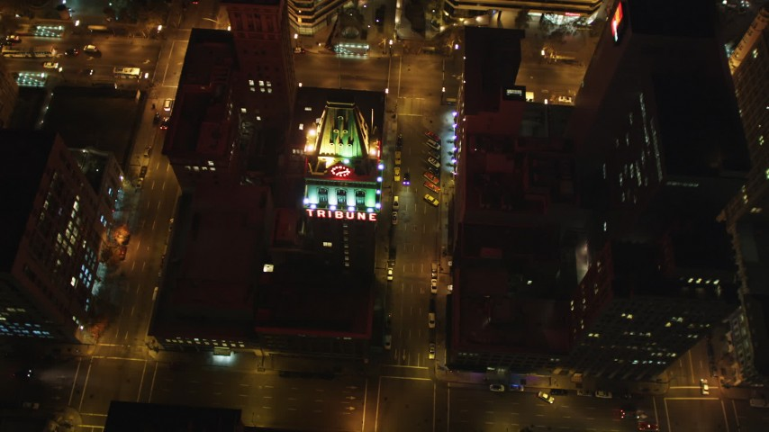 5K stock footage aerial video approach Tribune Tower office building and tilt to bird's eye view, Downtown Oakland, California, night Aerial Stock Footage | DFKSF07_082