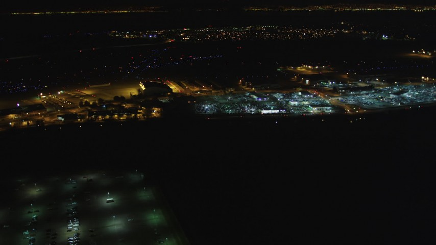 5K stock footage aerial video of flying by Oakland International Airport, Oakland, California, night Aerial Stock Footage | DFKSF07_090
