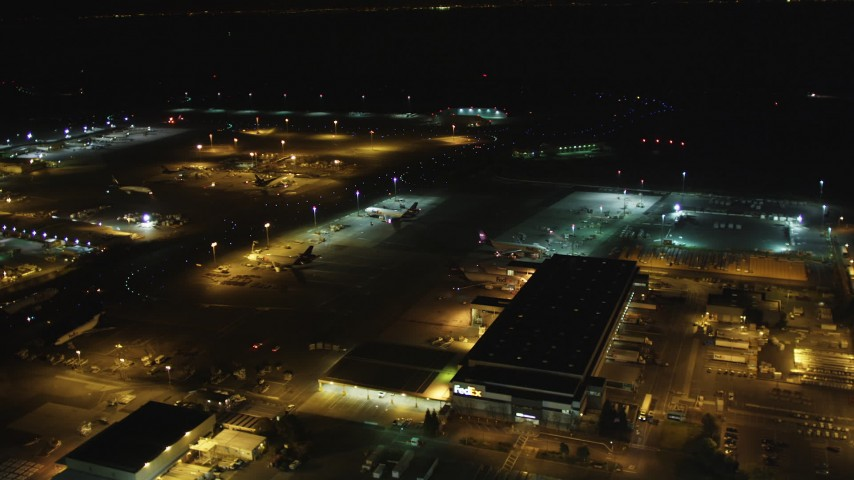 5K stock footage aerial video fly by FedEx terminal, Oakland International Airport, Oakland, California, night Aerial Stock Footage DFKSF07_091 | Axiom Images