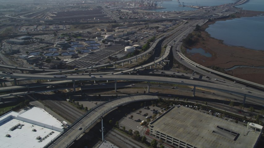 5K stock footage aerial video of flying by the MacArthur Maze freeway interchange, Oakland, California Aerial Stock Footage | DFKSF08_002
