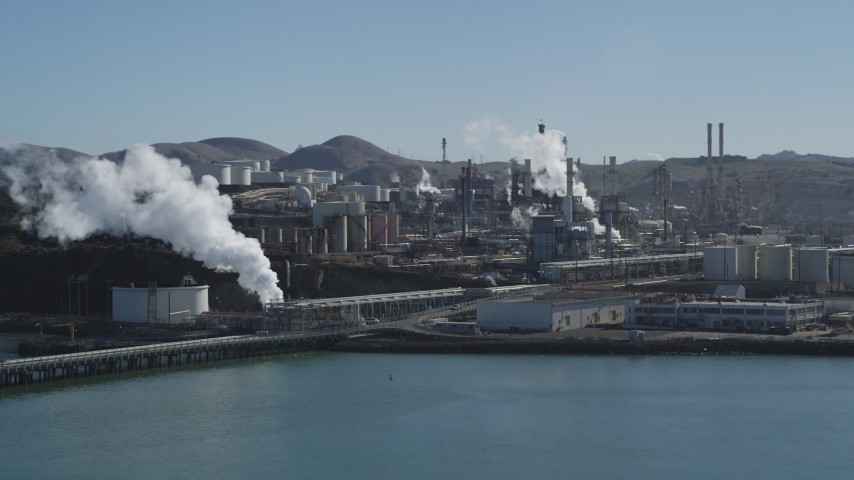 5K stock footage aerial video of flying away from the ConocoPhillips Oil Refinery, seen from San Pablo Bay, Rodeo, California Aerial Stock Footage DFKSF08_030 | Axiom Images