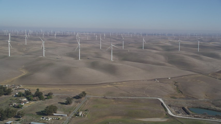5K stock footage aerial video of approaching windmills at Shiloh Wind Power Plant, Montezuma Hills, California Aerial Stock Footage   DFKSF08_071