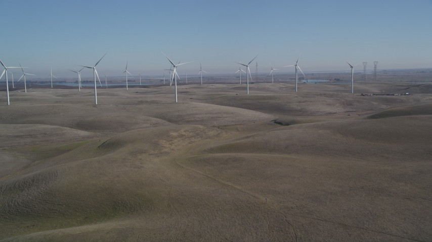 5K stock footage aerial video of approaching the windmills at Shiloh Wind Power Plant, Montezuma Hills, California Aerial Stock Footage | DFKSF08_073
