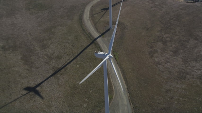 5K stock footage aerial video flyby and away from a windmill at Shiloh Wind Power Plant, Montezuma Hills, California Aerial Stock Footage | DFKSF08_075