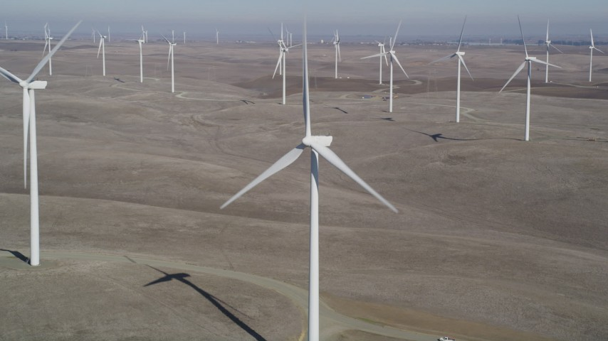 5K stock footage aerial video of flying close to a windmill at Shiloh Wind Power Plant, Montezuma Hills, California Aerial Stock Footage | DFKSF08_078