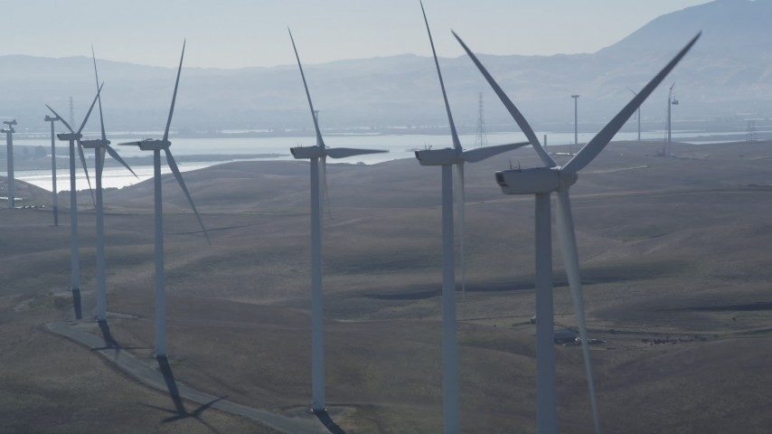 5K stock footage aerial video of flying by row of windmills, Shiloh Wind Power Plant, Montezuma Hills, California Aerial Stock Footage | DFKSF08_088